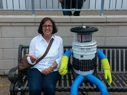 A good friend of mine with her new friend in Halifax before Hitchbot heads out.